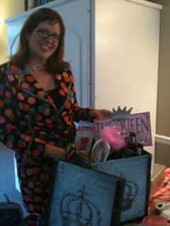 Shannon Mothershed poses with gifts for the Cracker Queen